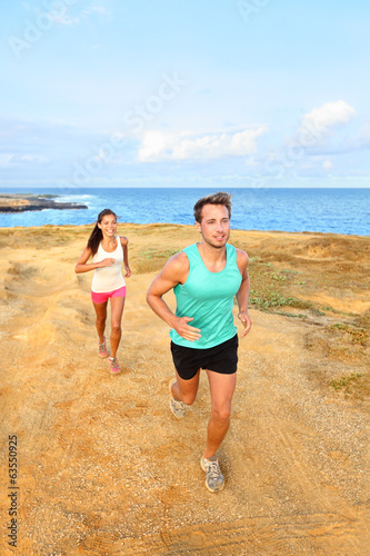 Runners running outside by ocean