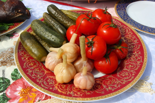 Traditional Russian tomatoes, pickled cucumbers and garlic