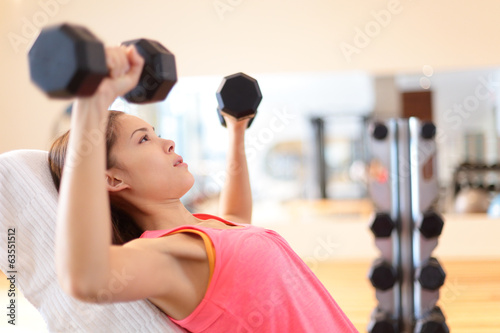 Gym woman strength training lifting weights