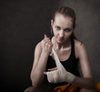 Woman boxer wearing white strap on wrist