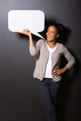 afro american woman holding speech bubble
