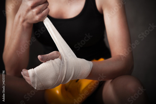 Female boxer wearing white strap on wrist