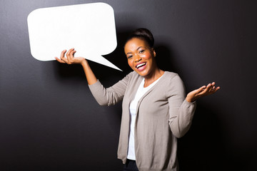 african girl holding blank speech bubble
