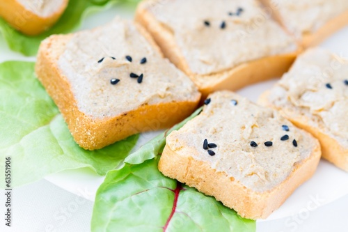 Slice of toasted baguette with creamy tuna paste