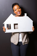 african girl holding paper house