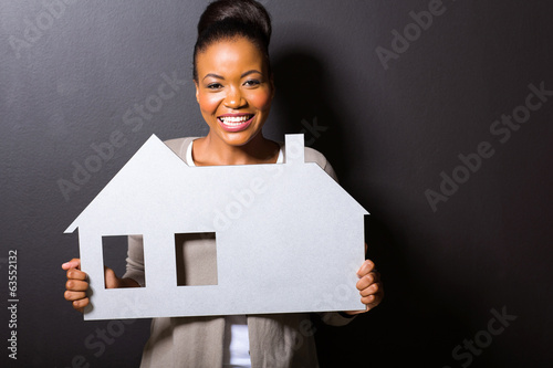 african woman holding a home symbol