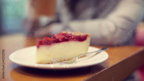 Tasty cheesecake on the table in cafe
