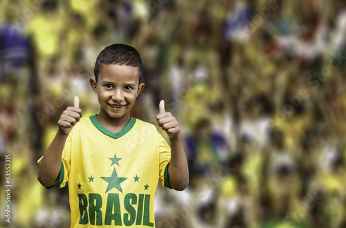 Brazilian fan boy celebrates on the stadium