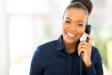 african businesswoman using landline phone