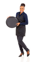 african waitress wearing apron