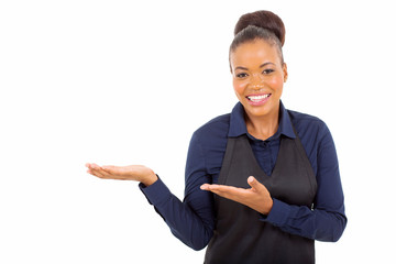 young african american waitress presenting copy space