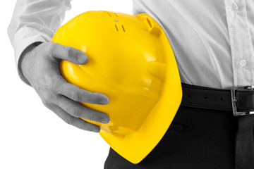 Man carrying a yellow hard hat