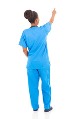 rear view of african american nurse pointing
