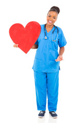 young african american doctor holding heart
