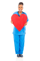 african nurse holding heart