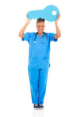 young african nurse holding a large key