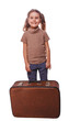brunette girl smiling child standing next to suitcase for travel