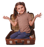 baby girl brunette sitting in a suitcase for travel isolated on