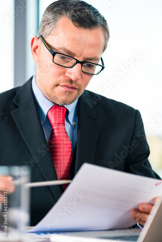 Businessman is working at office desk