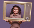 teen girl retro child framed television frame smiling on gray ba
