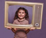 teen girl retro child framed television frame smiling on gray ba