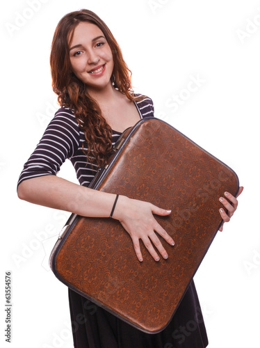 brunette smiling woman holding a suitcase has travel