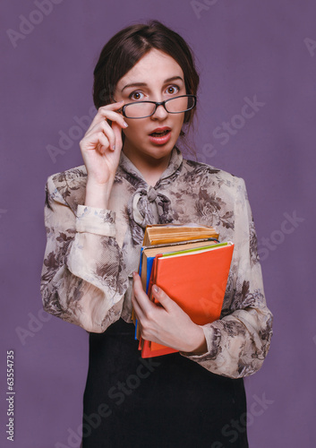 woman girl brunette teacher in glasses with books surprised open