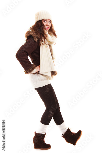 Winter fashion. Full length of curly girl woman in warm clothing