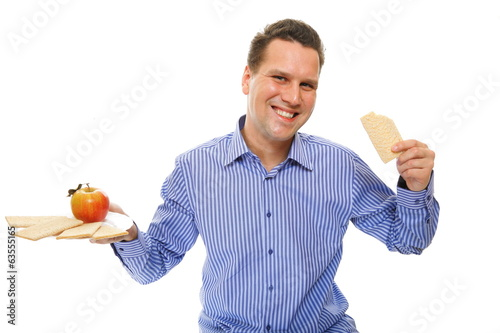 Healthy lifestyle man eating crispbread and apple
