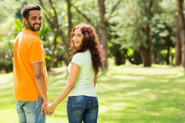cute indian couple holding hands