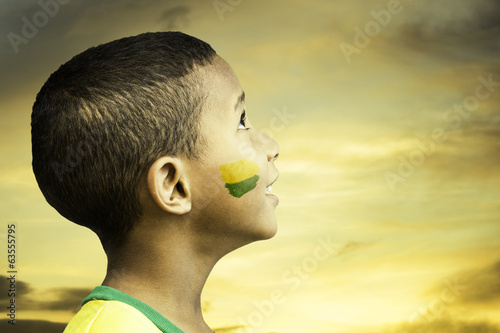 Brazilian little boy looks to the beautiful sky