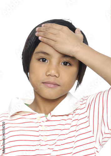 Little girl with headache on white background