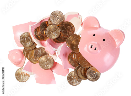 Broken Piggy Bank with Gold Coins isolated on white. Money