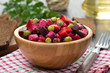 Russian beetroot salad vinaigrette in a wooden bowl