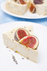 piese of cheesecake with honey and lavender and fresh figs