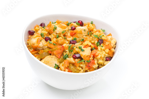 pilaf with vegetables, chicken and pomegranate, isolated