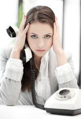 stressed and tired businesswoman with cell phone