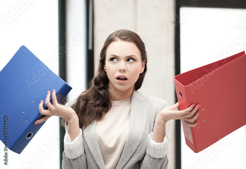 unsure thinking or wondering woman with folder