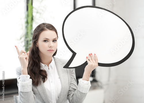 businesswoman holding blank text bubble