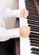 close up of child hands in fists hitting the piano