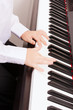 close up of child hands playing the piano