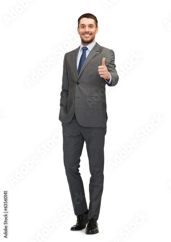 handsome buisnessman showing thumbs up
