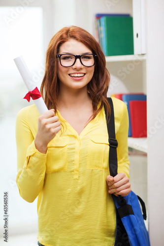 smiling female student with laptop bag and diploma