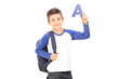 Boy with backpack holding the letter a