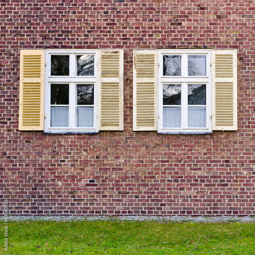 Windows in brick wall