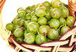 Green gooseberry in basket close-up