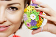 Young smiling woman with colorful easter egg