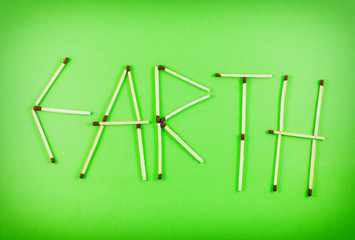 Word EARTH made of matchsticks