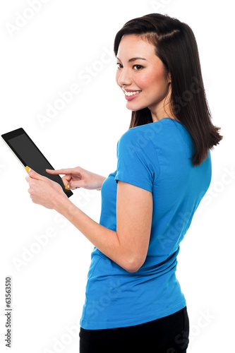 Beautiful woman using digital tablet