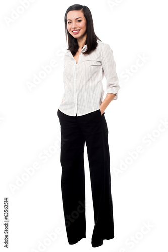 Full length portrait of trendy young woman